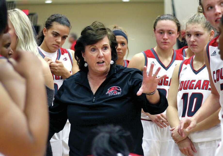 SIUE coach Paula Buscher talks to her team during a game last season. The Cougars opened the season Sunday with a victory over Illinois State. Photo: SIUE Athletics