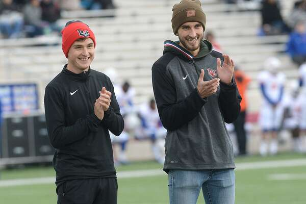 Lamar cross country members Jamie Crowe (left) and Jordan Rowe were honored for their winning season during Saturday's football game against Houston Baptist. Crowe was recently named the South Central Men's Athlete of the Year by USTFCCA and both will be heading to Madison, WI, for the NCAA national tournament. Photo taken Saturday, November 10, 2018 Kim Brent/The Enterprise