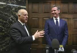 Governor-elect Gavin Newsom, right, smiles as Gov. Jerry Brown responds to a reporter's question after meeting at the Capitol, Tuesday, Nov. 13, 2018, in Sacramento, Calif. Newsom, who defeated Republican John Cox in the Nov. 6 election, will be sworn in to office Jan. 7, 2019. (AP Photo/Rich Pedroncelli)