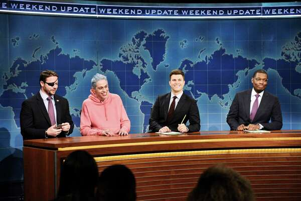 "In this Nov. 10, 2018 photo provided by NBC, Lt. Com. Dan Crenshaw, from left, a congressman-elect from Texas, Pete Davidson, Anchor Colin Jost, and Anchor Michael Che appear during Saturday Night Live?'s ""Weekend Update"" in New York. Davidson made his apologies to Crenshaw whose appearance he mocked, saying Crenshaw ?""deserves all the respect in the world.?"" (Will Heath/NBC via AP)"