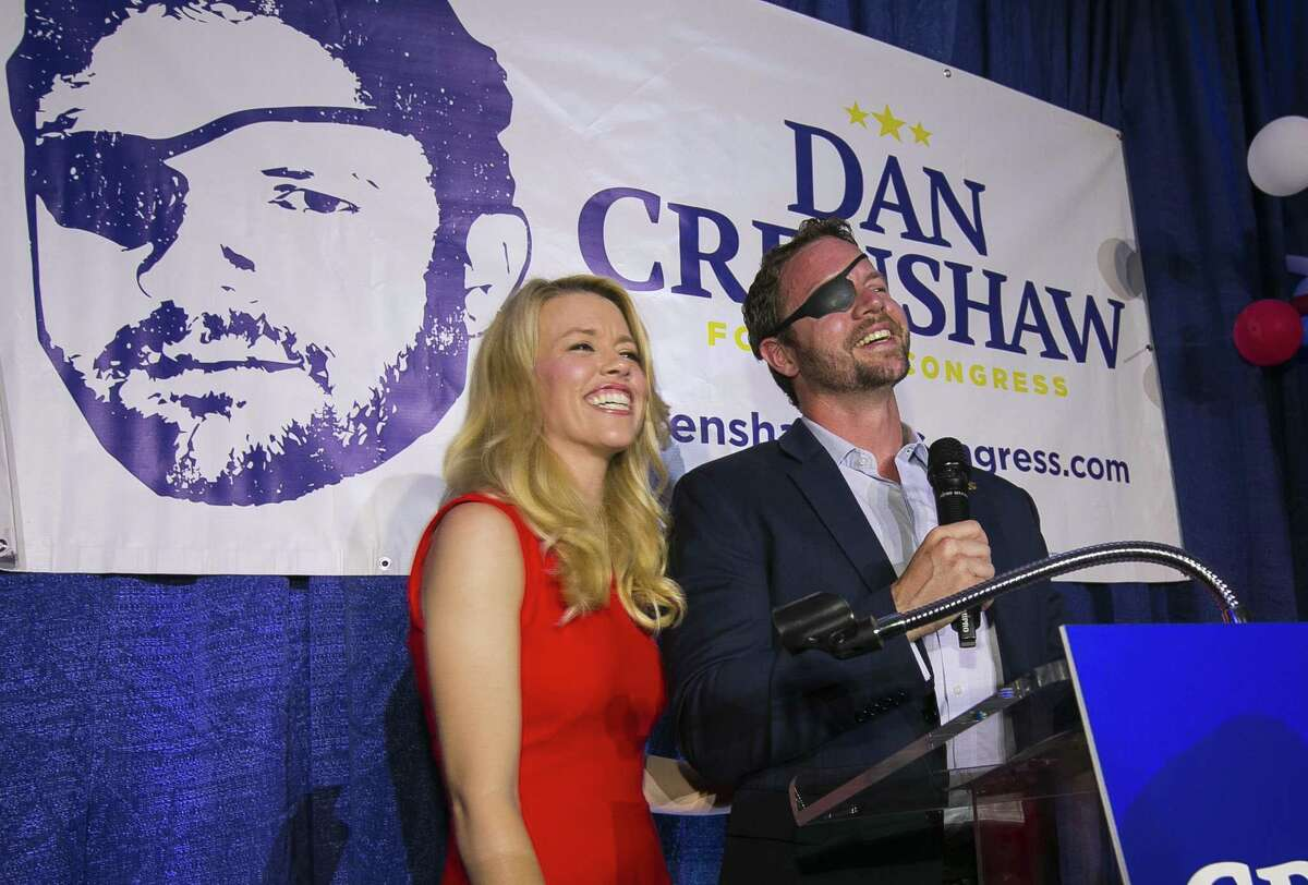 FILE - In this Tuesday, May 22, 2018, file photo, Republican congressional candidate Dan Crenshaw reacts to the crowd with his wife, Tara, as he comes on stage to deliver a victory speech during an election night party at the Cadillac Bar, in Houston. Crenshaw has chided ?