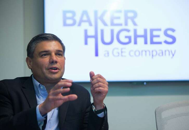 Baker Hughes CEO Lorenzo Simonelli speaks during a meeting at the company's offices in north Houston.