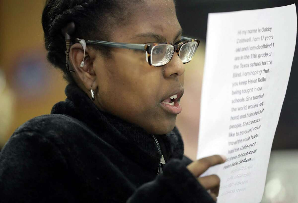 Gabrielle Caldwell, who is partially deaf and blind, looks over her notes where she testified before the Texas School Board during public testimony as they prepares to vote on history curriculum, Tuesday, Nov. 13, 2018, in Austin, Texas. (AP Photo/Eric Gay)
