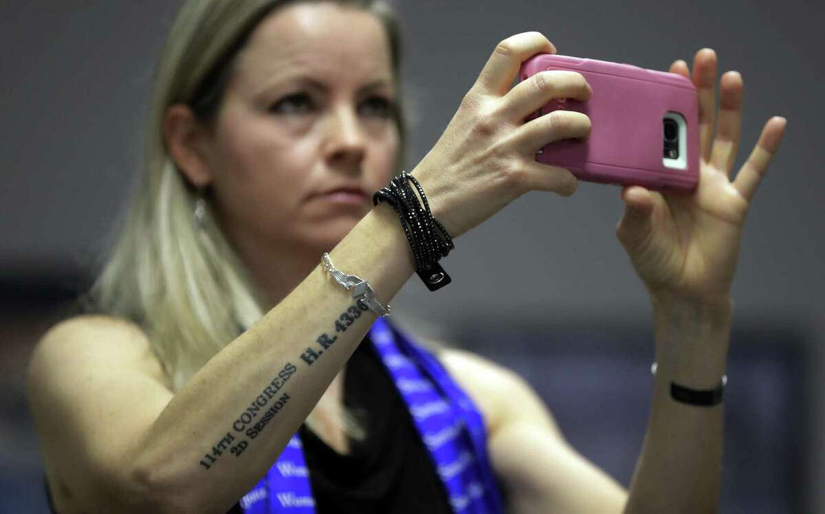 Erin Miller, with a tattoo honoring the Women's Airfare Service Pilots, attends a Texas School Board during public testimony as they prepares to vote on history curriculum, Tuesday, Nov. 13, 2018, in Austin, Texas. Miller spoke in defense of keeping Women's Airfare Service Pilots in the curriculum. (AP Photo/Eric Gay)