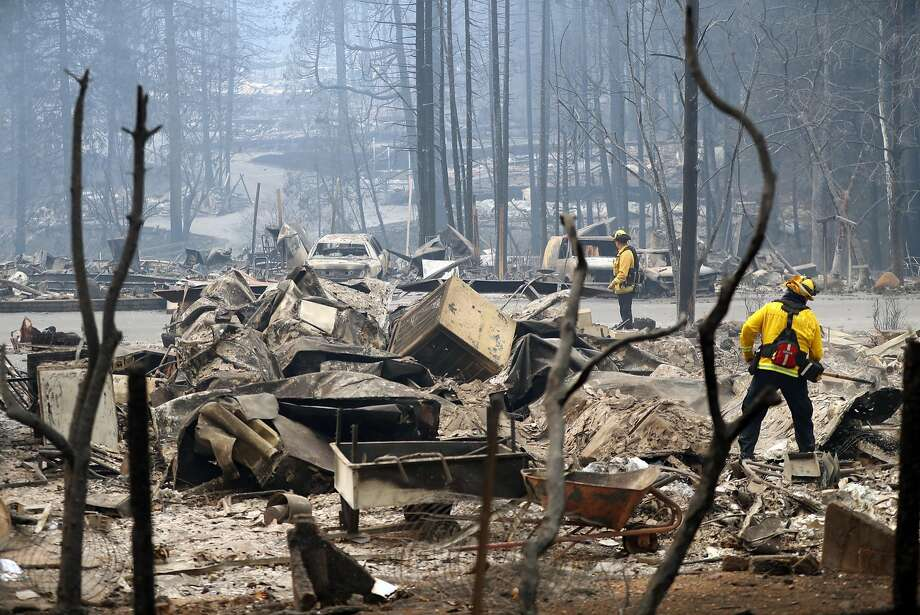 A Monterey firefighters put out small hot spots in Eden Rock Estates in aftermath of Camp Fire in Paradise, Calif. on Tuesday, November 13, 2018. Photo: Scott Strazzante / The Chronicle