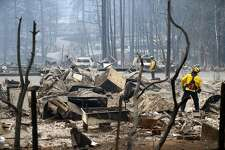 A Monterey firefighters put out small hot spots in Eden Rock Estates in aftermath of Camp Fire in Paradise, Calif. on Tuesday, November 13, 2018.