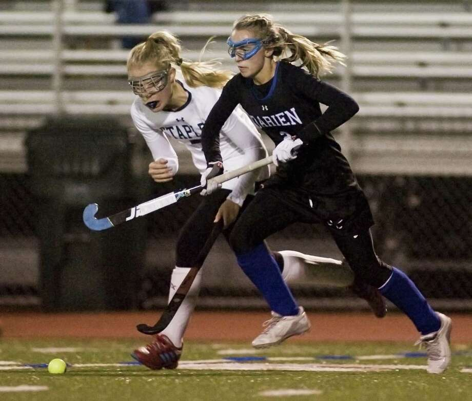 Staples's Hannah Paprotna, left, and Darien's Molly Hellman chase the ball in the Class L semifinals played at Brien McMahon High in Norwalk on Tuesday. Photo: Scott Mullin / For Hearst Connecticut Media / The News-Times Freelance