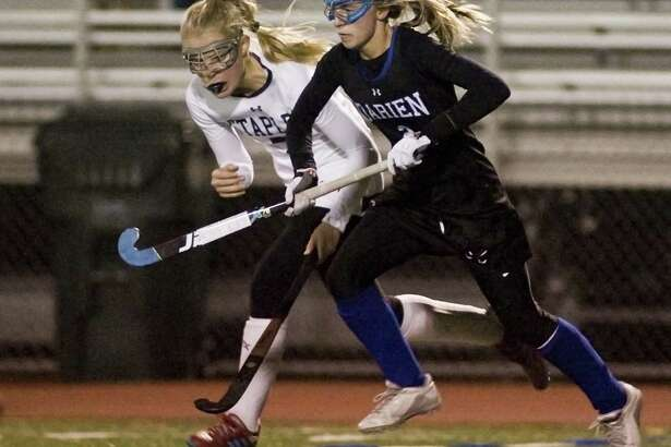 Staples's Hannah Paprotna, left, and Darien's Molly Hellman chase the ball in the Class L semifinals played at Brien McMahon High in Norwalk on Tuesday.