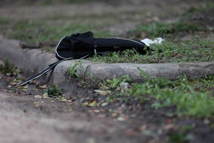 A black backpack is left at the scene where a shooting left one Lamar High School student died near the intersection of Bammel Lane and Philfall Street on Tuesday, Nov. 13, 2018, in Houston.