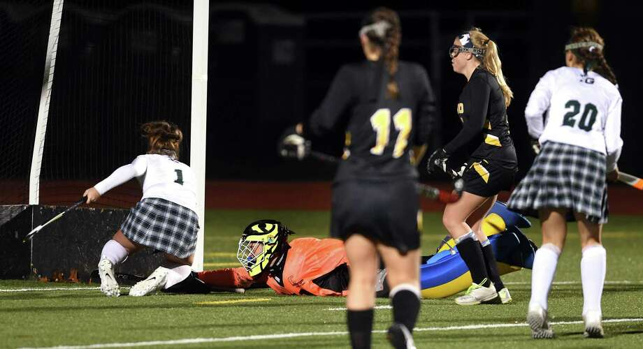 Daniel Hand goalie Karen Newton (center) is too late as Celia Mariconda (left) of Guilford scores in the second half of the CIAC Class M field hockey semifinals in Wallingford on November 13, 2018. Guilford won 1-0. Photo: Arnold Gold / Hearst Connecticut Media / New Haven Register