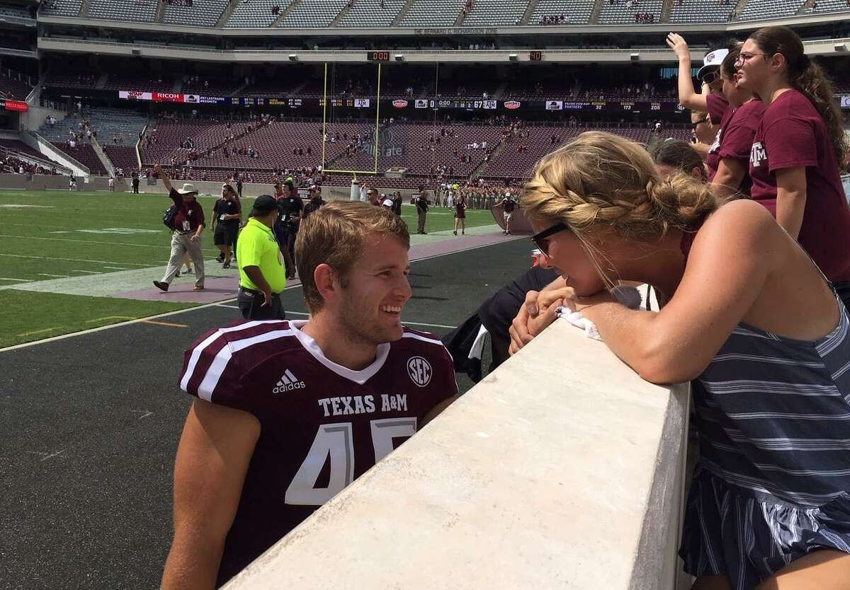 Senior deep snapper Austin Frey, pictured with wife Maddie, is Texas A&M's only married player.