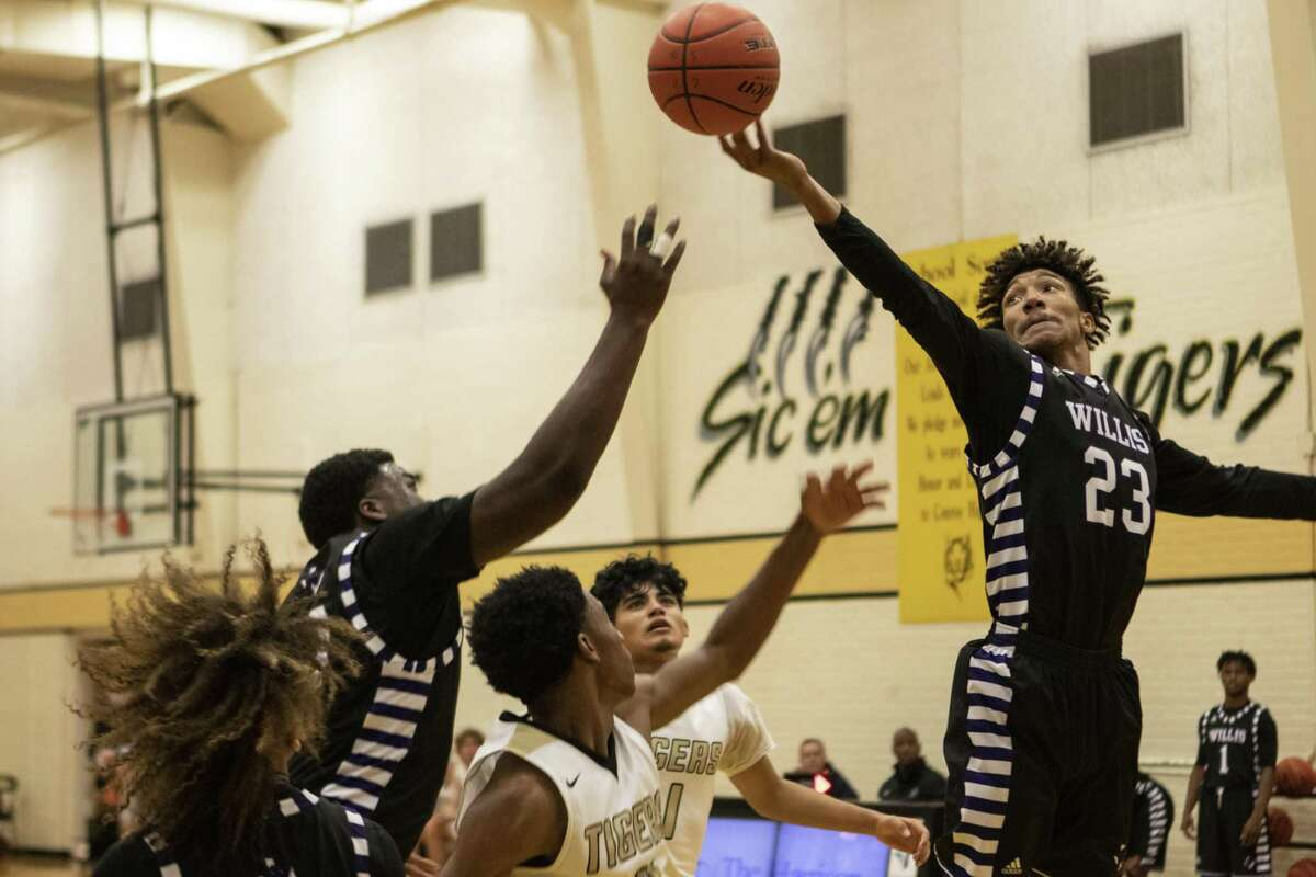 Willis senior Ronald Finister (23) reaches out over the other players for a rebound during a non-district basketball game Tuesday, Nov. 13, 2018 at The Pit in Conroe.