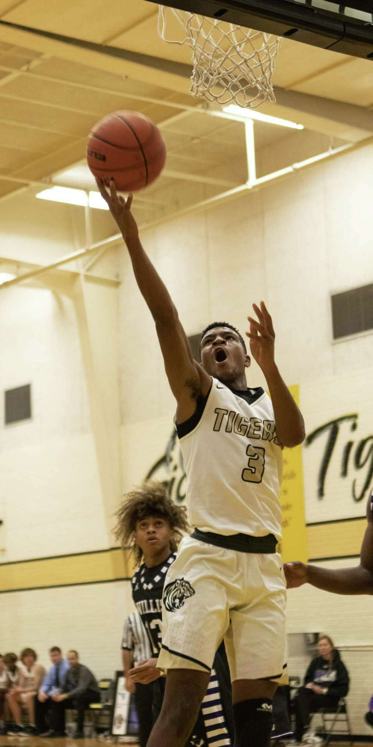 Conroe junior Michael Phoenix (3) goes up to score during a non-district basketball game Tuesday, Nov. 13, 2018 at The Pit in Conroe.
