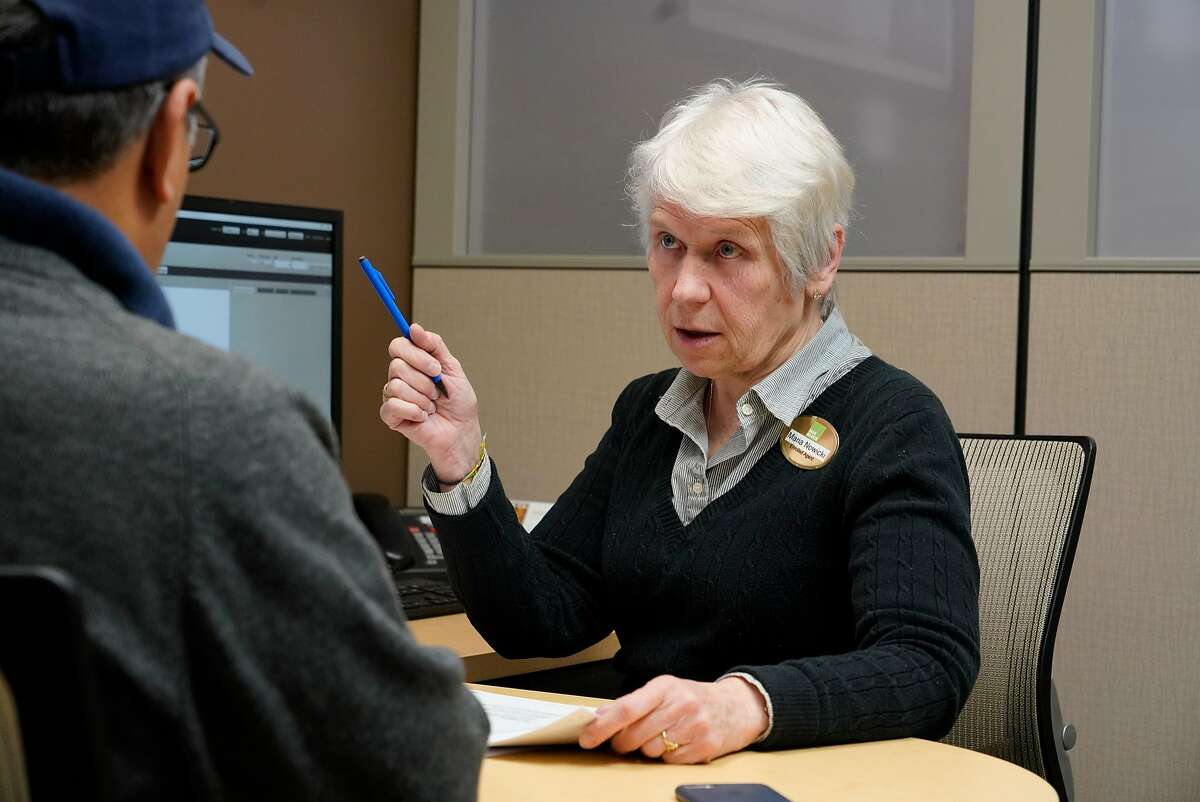 Maria Nowicki (right), senior tax advisor H & R Block, works with a client on his taxes at her office on Tuesday, November 13, 2018 in San Francisco, Calif.