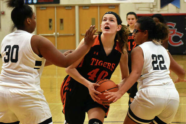 Edwardsville's Katelynne Roberts drives between two defenders on her way to the basket in the second half.