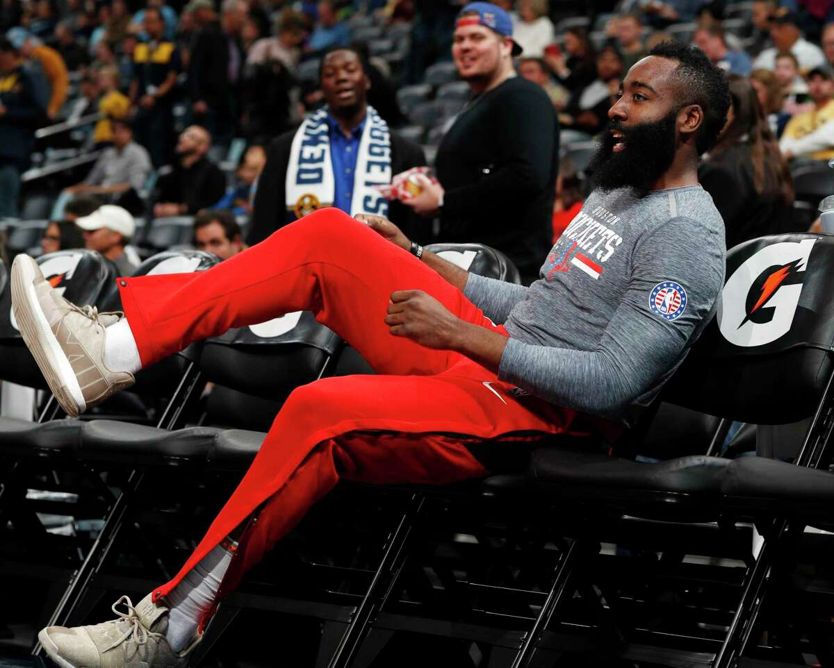 Houston Rockets guard James Harden jumps on a seat on the bench before facing the Denver Nuggets in an NBA basketball game Tuesday, Nov. 13, 2018, in Denver. (AP Photo/David Zalubowski)
