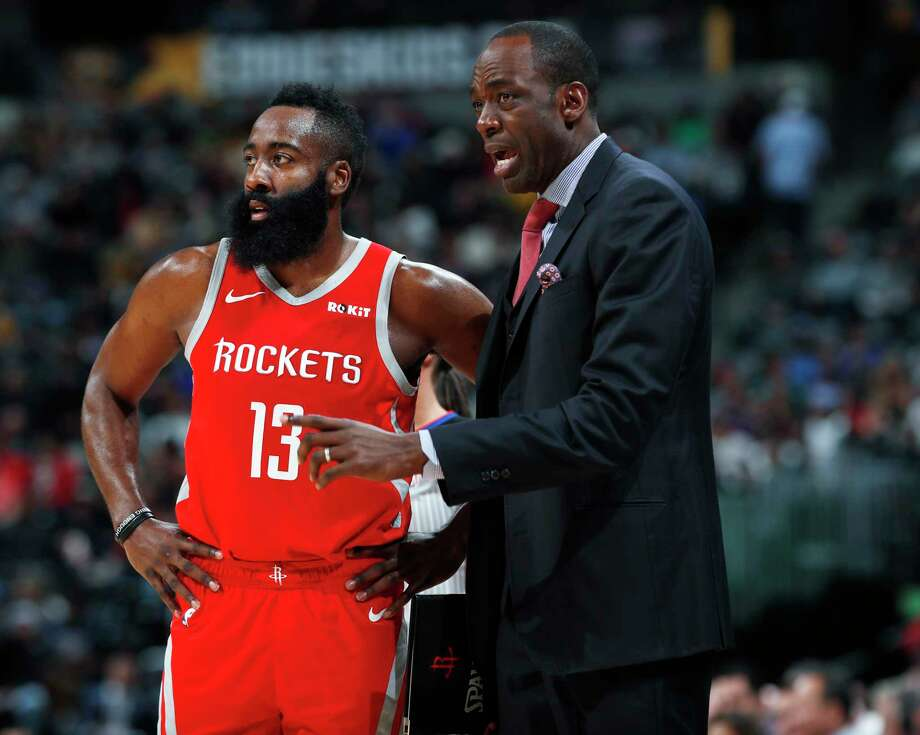 Houston Rockets guard James Harden, left, confers with assistant coach Roy Rogers during a break in the first half of an NBA basketball game against the Denver Nuggets, Tuesday, Nov. 13, 2018, in Denver. (AP Photo/David Zalubowski) Photo: David Zalubowski, Associated Press / Copyright 2018 The Associated Press. All rights reserved.