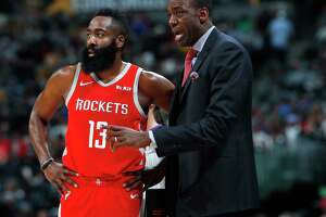 Houston Rockets guard James Harden, left, confers with assistant coach Roy Rogers during a break in the first half of an NBA basketball game against the Denver Nuggets, Tuesday, Nov. 13, 2018, in Denver. (AP Photo/David Zalubowski)