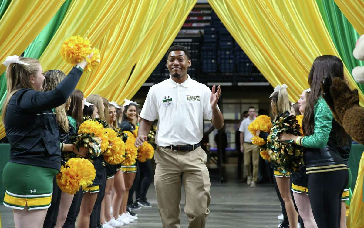 """Siena guard Jalen Pickett waves to fans as he arrives for the Siena men's and women's basketball teams annual ?""""Sneak Preview?"""" Monday Oct. 22, 2018 at the Times Union Center."""