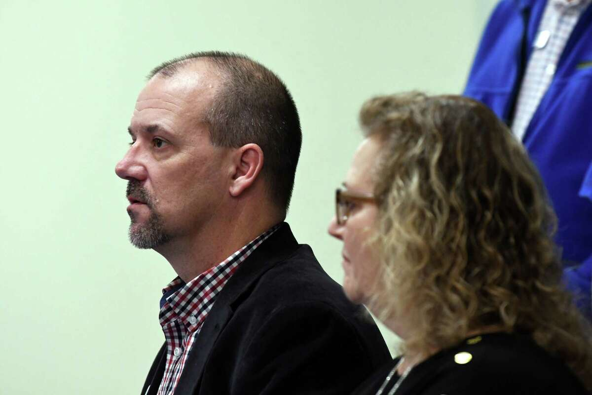 Mohawk Hudson Humane Society president Todd Cramer, left, and Cynthia LaFave, board chair, right, speak during a press conference about Luna, a Troy dog which the society is trying to save after it was scheduled to be euthanized after an apparent biting incident on Tuesday, Nov. 13, 2018, in Menands, N.Y. Troy law says an animal can be deemed dangerous after one bite and she was ordered to be euthanized. (Will Waldron/Times Union)