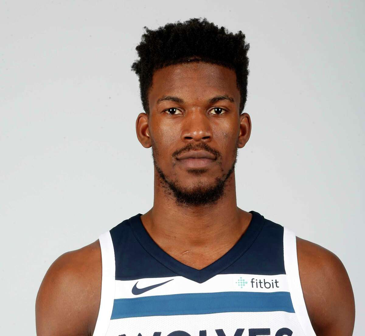 File-This Sept. 22, 2017, file photo shows Minnesota Timberwolves' Jimmy Butler posing during the NBA basketball team media day in Minneapolis. Butler is headed to Philadelphia, ending the weeks-long saga of him wanting out of Minnesota. A person with knowledge of the situation says Butler is being traded to the 76ers in a package that will send Dario Saric and Robert Covington to the Timberwolves. (AP Photo/Jim Mone, File)