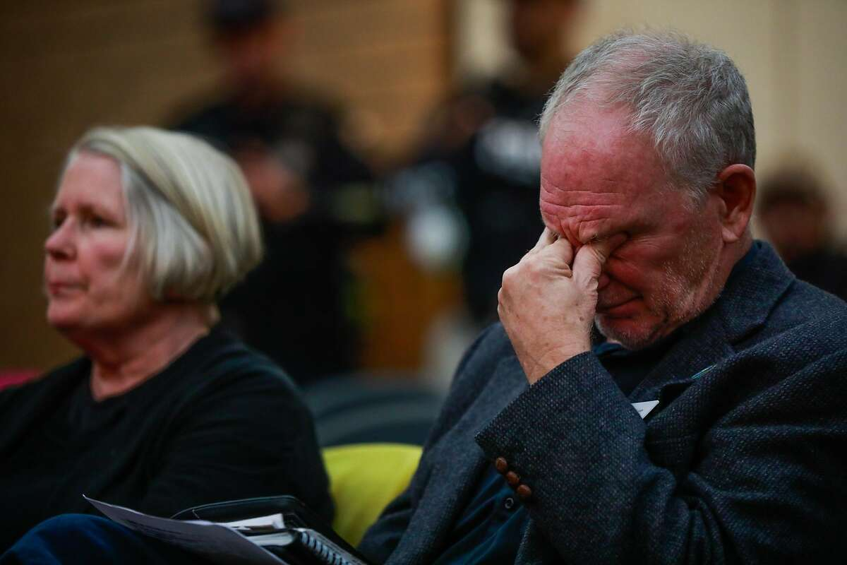 Karl Ory (right) rubs his eyes during the Paradise town council meeting which was being held at the Chico City Council due to the Camp Fire in Chico, California, on Tuesday, Nov. 13, 2018.