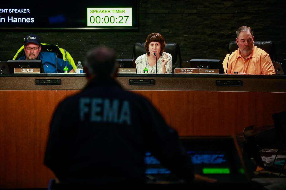 Paradise Mayor Jody Joness speaks to FEMA representative Kevin Hannes as he speaks during the Paradise town council meeting which was being held at the Chico City Council due to the Camp Fire in Chico, California, on Tuesday, Nov. 13, 2018.