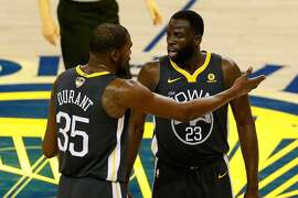 OAKLAND, CA - JUNE 03: Kevin Durant #35 of the Golden State Warriors talks with Draymond Green #23 against the Cleveland Cavaliers in Game 2 of the 2018 NBA Finals at ORACLE Arena on June 3, 2018 in Oakland, California. NOTE TO USER: User expressly acknowledges and agrees that, by downloading and or using this photograph, User is consenting to the terms and conditions of the Getty Images License Agreement. (Photo by Lachlan Cunningham/Getty Images)
