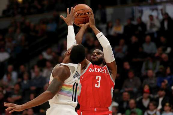 Chris Paul, who contributed 21 points to a balanced Rockets attack, shoots over the Nuggets' Gary Harris.