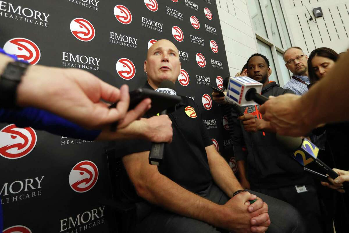 Atlanta Hawks general manager and head of basketball operations Travis Schlenk speaks to reporters after it was announced the team and head basketball coach Mike Budenholzer have decided to part ways Thursday, April 26, 2018, in Atlanta. (AP Photo/John Bazemore)
