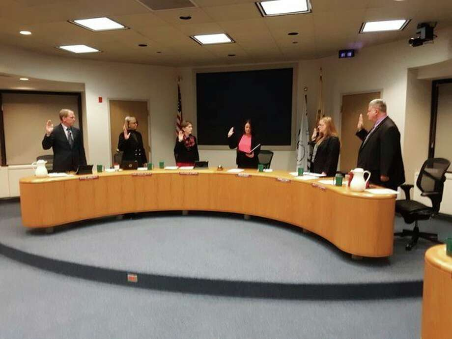 Midland City Councilmembers take the oath of office as they begin a new term. From left are Steve Arnosky, Ward 3; Diane Brown Wilhelm, Ward 4; Mayor Maureen Donker, Ward 2; City Clerk Selina Tisdale; Pam Hall, Ward 1; and Marty Wazbinski, Ward 5.(John Kennett/jkennett@mdn.net)