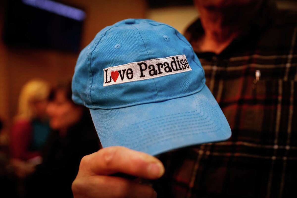 Paradise resident Ward Habriel shows off his cap after the Paradise town council meeting which was being held at the Chico City Council due to the Camp Fire in Chico, California, on Tuesday, Nov. 13, 2018.