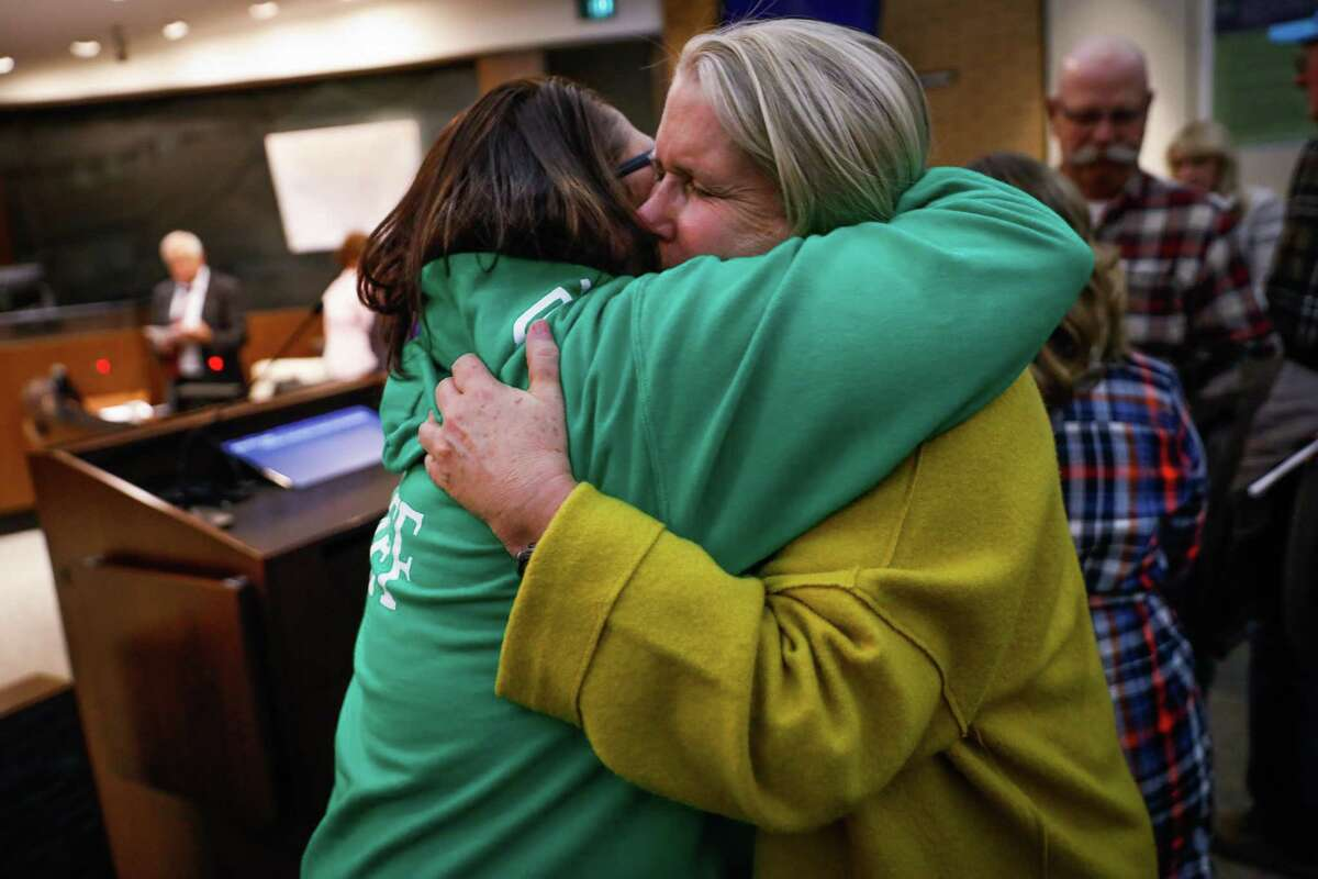 Ann Schwab (right) hugs Rashell Brobst (left) after the Paradise town council meeting which was being held at the Chico City Council due to the Camp Fire in Chico, California, on Tuesday, Nov. 13, 2018.