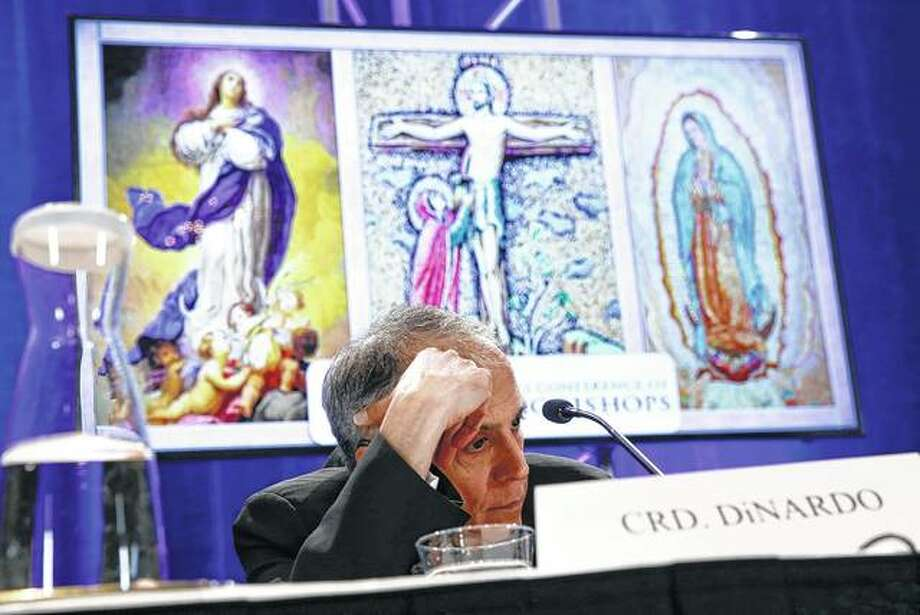 Cardinal Daniel DiNardo of the Archdiocese of Galveston-Houston, president of the United States Conference of Catholic Bishops, sits in a news conference Monday during the USCCB's annual fall meeting in Baltimore. Photo: Patrick Semansky | Associated Press