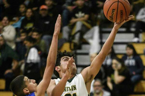 JC Ayala and Nixon defeated Cigarroa 94-44 Tuesday night. Ayala led the Mustangs with 19 points.
