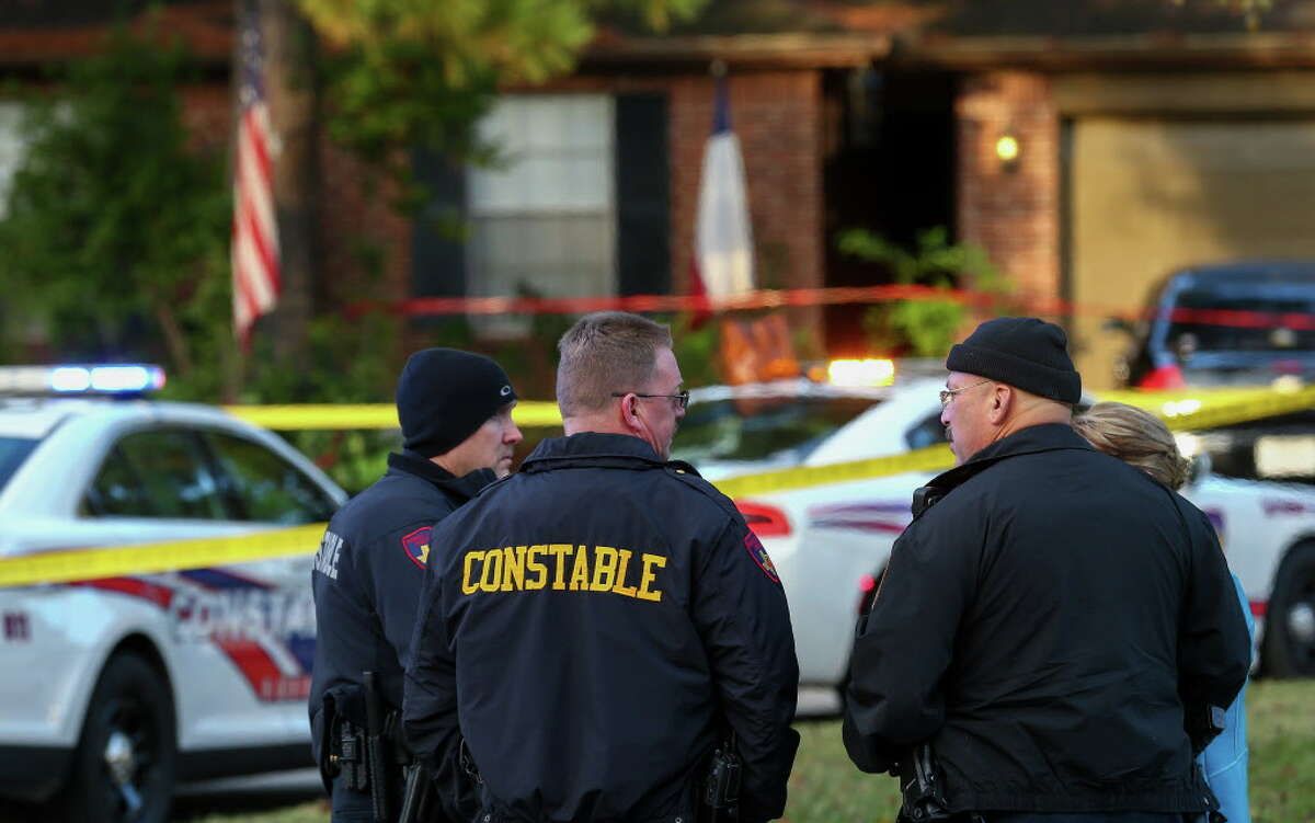 Harris County Sheriff's Precinct 4 constables investigate the scene of a fatal shooting on the 3400 block of Meadowhill Court Wednesday, Nov. 14, 2018, in Spring, Texas.