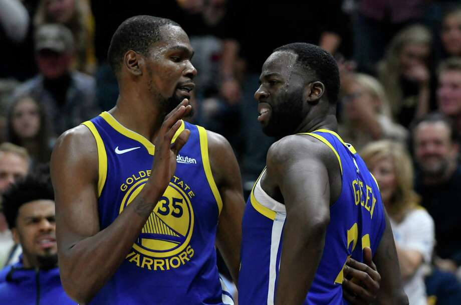 SALT LAKE CITY, UT - OCTOBER 19: Kevin Durant #35 of the Golden State Warriors tries to calm down teammate Draymond Green #23 after a foul in the second half of a NBA game against the Utah Jazz at Vivint Smart Home Arena on October 19, 2018 in Salt Lake City, Utah. NOTE TO USER: User expressly acknowledges and agrees that, by downloading and or using this photograph, User is consenting to the terms and conditions of the Getty Images License Agreement. Photo: Gene Sweeney Jr., Getty Images / 2018 Getty Images