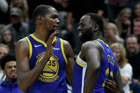 SALT LAKE CITY, UT - OCTOBER 19: Kevin Durant #35 of the Golden State Warriors tries to calm down teammate Draymond Green #23 after a foul in the second half of a NBA game against the Utah Jazz at Vivint Smart Home Arena on October 19, 2018 in Salt Lake City, Utah. NOTE TO USER: User expressly acknowledges and agrees that, by downloading and or using this photograph, User is consenting to the terms and conditions of the Getty Images License Agreement.