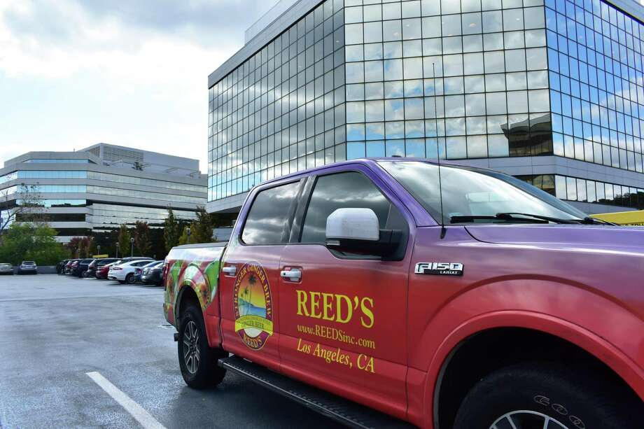 A Reed's corporate vehicle in October 2018 at the Merritt 7 office complex it now calls home, after the ginger beer maker moved its main office east from Los Angeles in the third quarter. Photo: Alexander Soule / Hearst Connecticut Media / Stamford Advocate