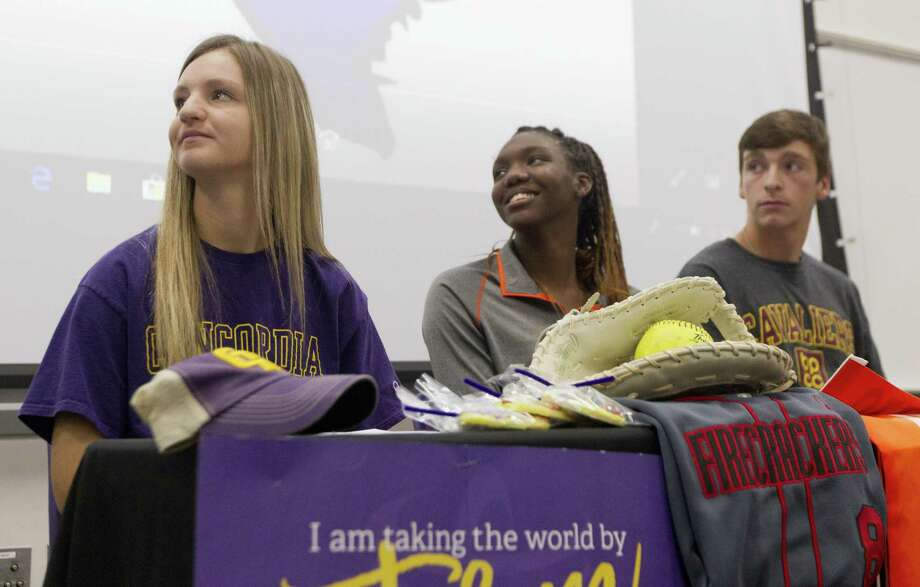Sarah Brooks is seen next to fellow signees De'Janae Gilmore and Daniel Shafer during a national signing day ceremony at Willis High School, Wednesday, Nov. 14, 2018, in Willis. Brooks signed to play softball for Concordia University, while Gilmore signed to play volleyball for Sam Houston State University and Shafer signed to play baseball for Bosier Parish Community College. Photo: Jason Fochtman, Houston Chronicle / Staff Photographer / © 2018 Houston Chronicle