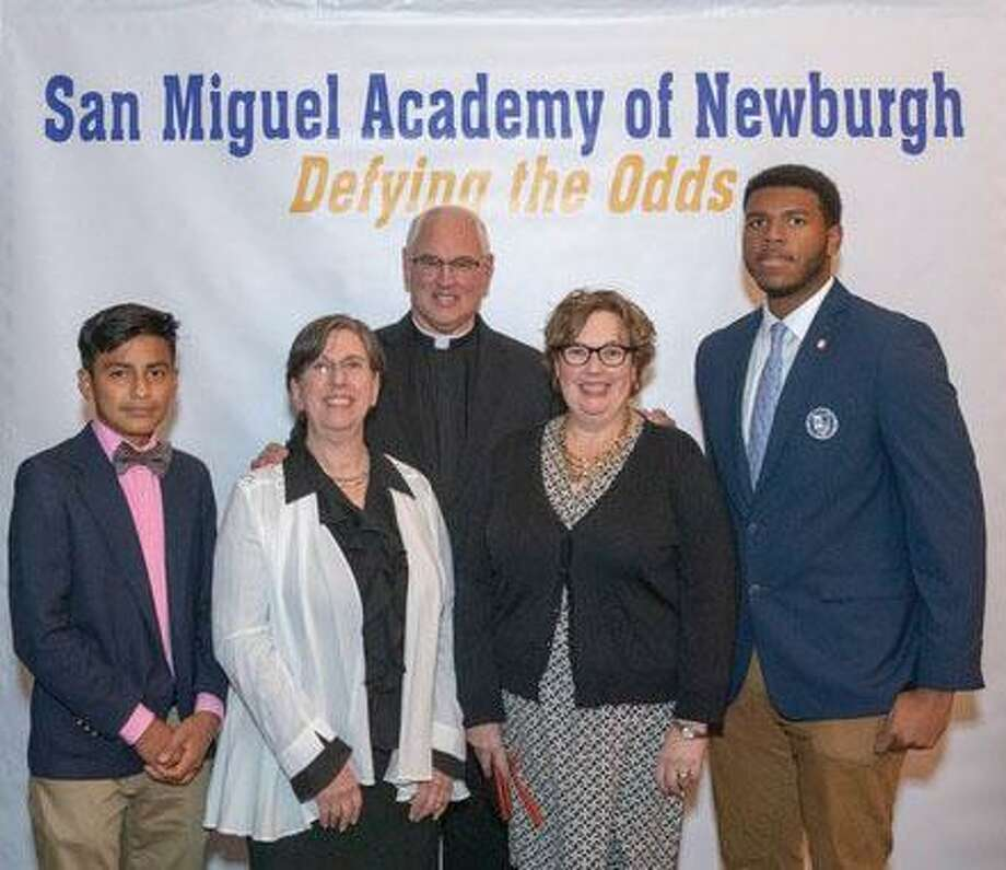 Among those who attended the recent scholarship dinner are, from left to right, San Miguel Academy graduate and Marvelwood student Axel Juarez, Sandy Singco, chair of the Learning Support Department at Marvelwood School, Father Mark Connell, founder and executive director at San Miguel Academy of Newburgh, Maureen Smith, associate director of admissions at Marvelwood School and Avante Walker, San Miguel Academy graduate and Marvelwood student. Photo: Courtesy Of Simon Feldman / The News-Times Contributed