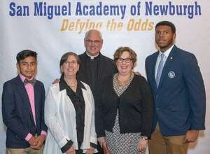 Among those who attended the recent scholarship dinner are, from left to right, San Miguel Academy graduate and Marvelwood student Axel Juarez, Sandy Singco, chair of the Learning Support Department at Marvelwood School, Father Mark Connell, founder and executive director at San Miguel Academy of Newburgh, Maureen Smith, associate director of admissions at Marvelwood School and Avante Walker, San Miguel Academy graduate and Marvelwood student.
