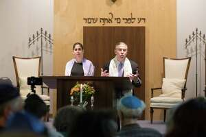 During the Kristallnacht memorial service at Temple Sholom Friday evening Cantor Laura Breznick and Rabbi Ari Rosenberg get ready for the candle blessings. This November marks the 80th anniversary of Kristallnacht.