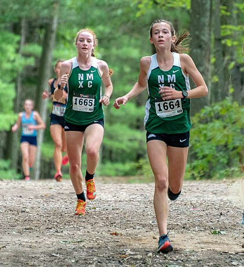 From left, Katie Delaney Claire Daniels get out in front of the pack at the Winding Trails Invitational on Sept. 22, 2018. Photo: / Gerard Bianchi