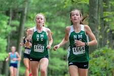 From left, Katie Delaney Claire Daniels get out in front of the pack at the Winding Trails Invitational on Sept. 22, 2018.