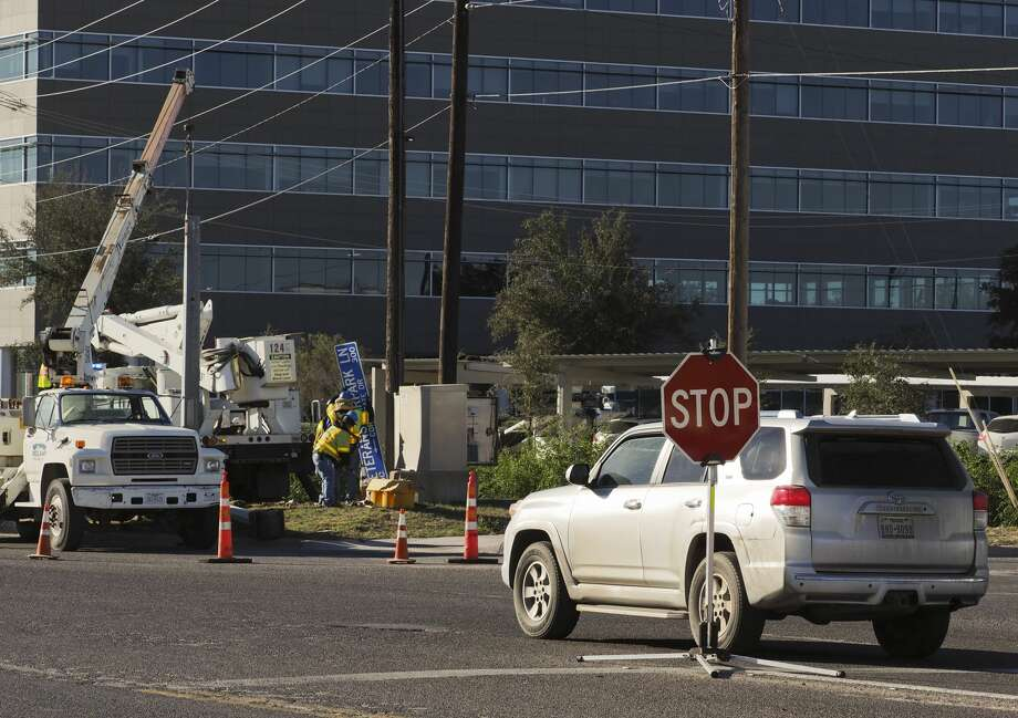 Crews work to replace a light pole at the intersection of Big Spring and Veterans Airpark Lane 11/14/18 morning after an early morning accident knocked the south bound lights down and caused the intersection to have blinking reds all directions. Tim Fischer/Reporter-Telegram Photo: Tim Fischer/Midland Reporter-Telegram
