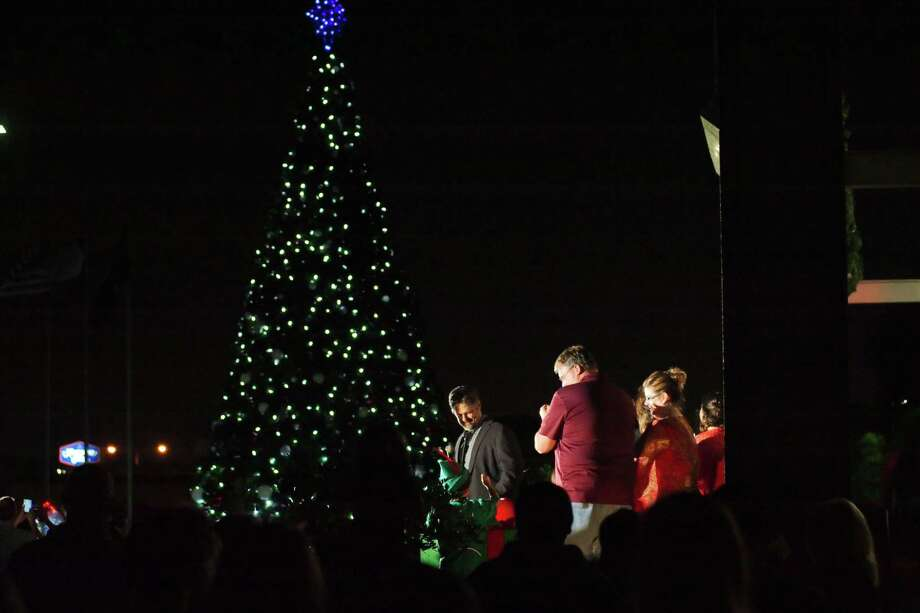 Deer Park Mayor Jerry Mouton pushes the button to light the city's Christmas tree during a previous holiday event. / Internal
