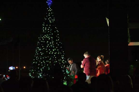 Deer Park Mayor Jerry Mouton pushes the button to light the community Christmas tree at a previous holiday celebration. This year, the tree-lighting is set for 6 p.m. Nov. 30 at the city's Theater and Court Buildings, 1302 Center St.