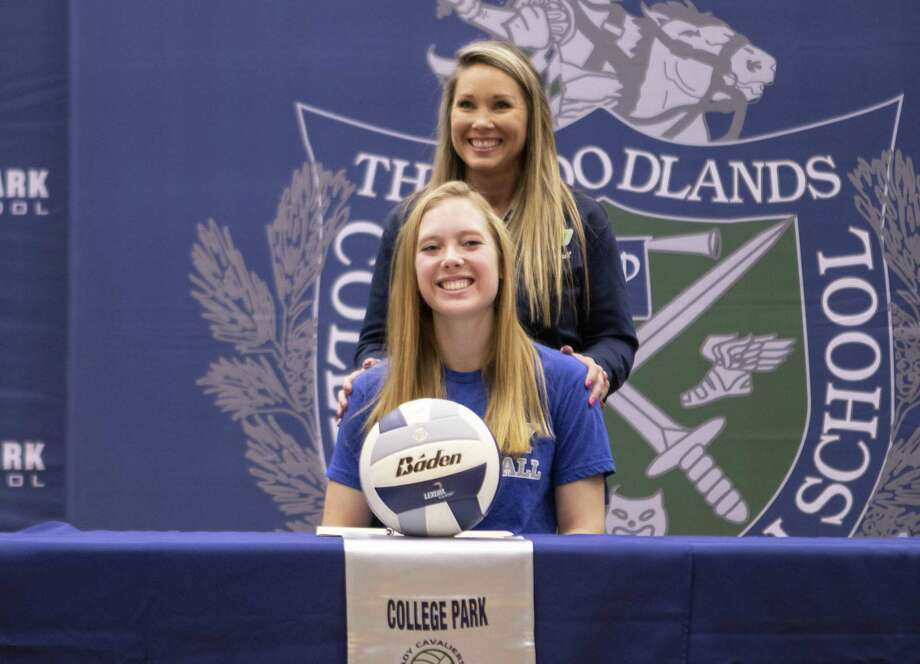 College Park senior Samantha Schultz smiles while volleyball head coach Candace Gibson speaks about Schultz' success in the sport and academics Wednesday, Nov. 14, 2018 at The Woodlands College Park High School in The Woodlands. Schultz has committed to Colby College in Waterville, Maine. Photo: Cody Bahn, Houston Chronicle / Staff Photographer / © 2018 Houston Chronicle