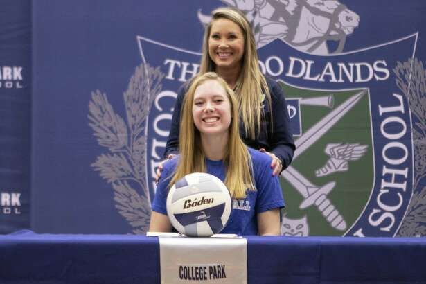 College Park senior Samantha Schultz smiles while volleyball head coach Candace Gibson speaks about Schultz?' success in the sport and academics Wednesday, Nov. 14, 2018 at The Woodlands College Park High School in The Woodlands. Schultz has committed to Colby College in Waterville, Maine.